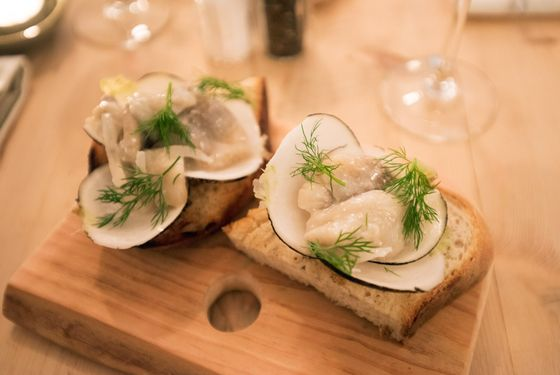 Grilled rye bread with sablefish, radish and dill.