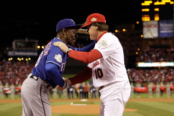 ST LOUIS, MO - OCTOBER 19:  (L-R) Manager Ron Washington #38 of the Texas Rangers and manager Tony La Russa #10 of the St. Louis Cardinals and shake hands prior to the start of Game One of the MLB World Series at Busch Stadium on October 19, 2011 in St Louis, Missouri.  (Photo by Paul Sancya-Pool/Getty Images)