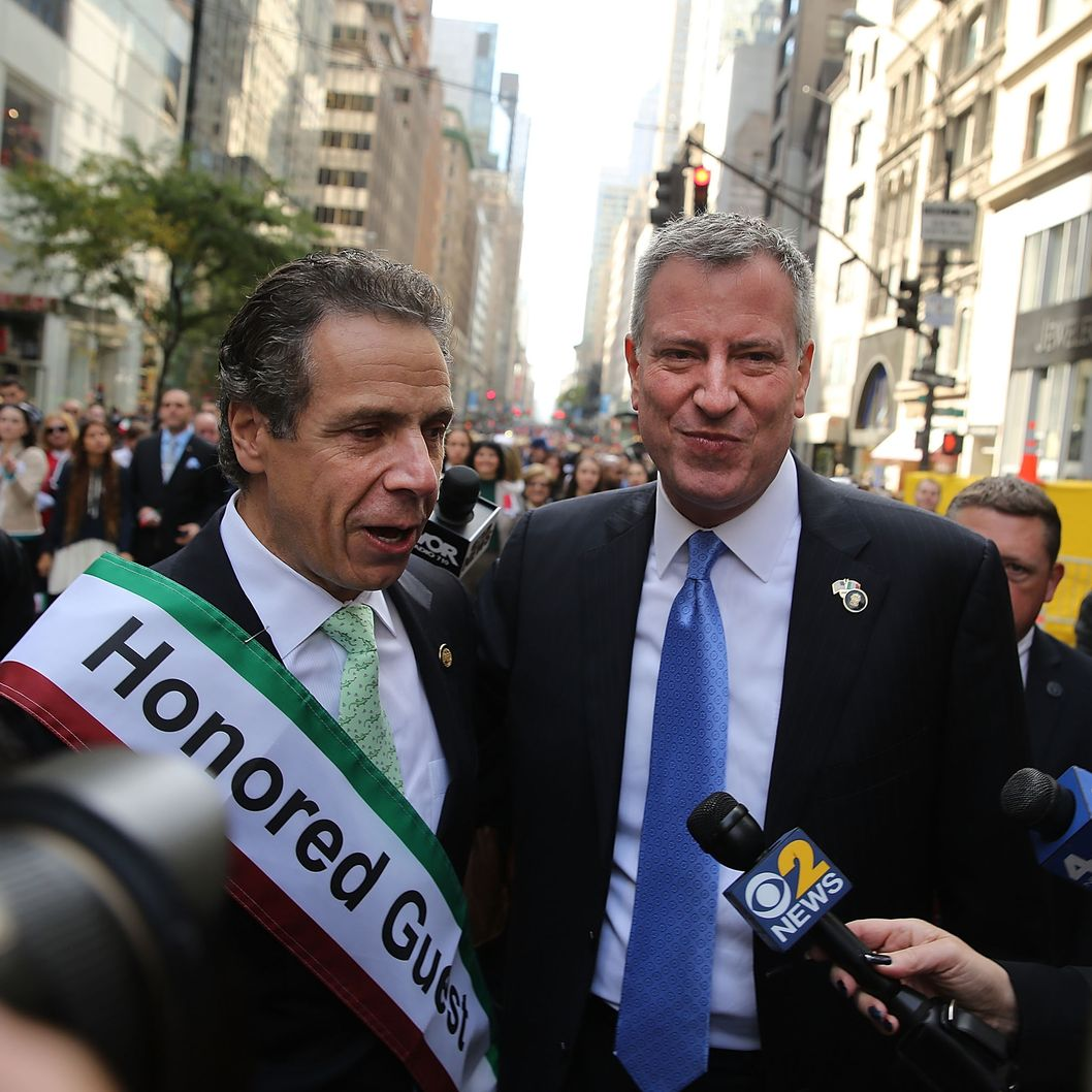NEW YORK, NY - OCTOBER 14:  Democratic new York City mayoral candidate Bill de Blasio (R) speaks with New York Governor Andrew Cuomo while marching in the 69th Annual Columbus Day Parade on October 14, 2013 in New York City. With dozens of floats, marching bands and politicians on hand, the annual celebration of Italian American culture and heritage draws large crowds along 5th Avenue.  (Photo by Spencer Platt/Getty Images)