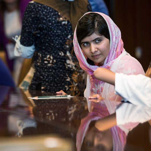 "Malala Yousafzai, the 16-year-old Pakistani advocate for girls education who was shot in the head by the Taliban, attends a conversation with the United Nations Secretary General Ban-ki Moon  Ban-ki Moon and other youth delegates at the United Nations Youth Assembly on July 12, 2013 in New York City. The United Nations declared July 12 ""Malala Day."" Yousafzai also celebrates her birthday today."