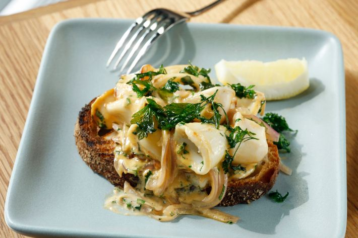 Calamari, paprika aioli, red onion, parsley, and grilled bread