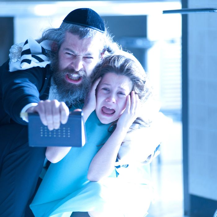 Tzadok (Matisyahu) and Em (Natasha Calis) in THE POSSESSION.