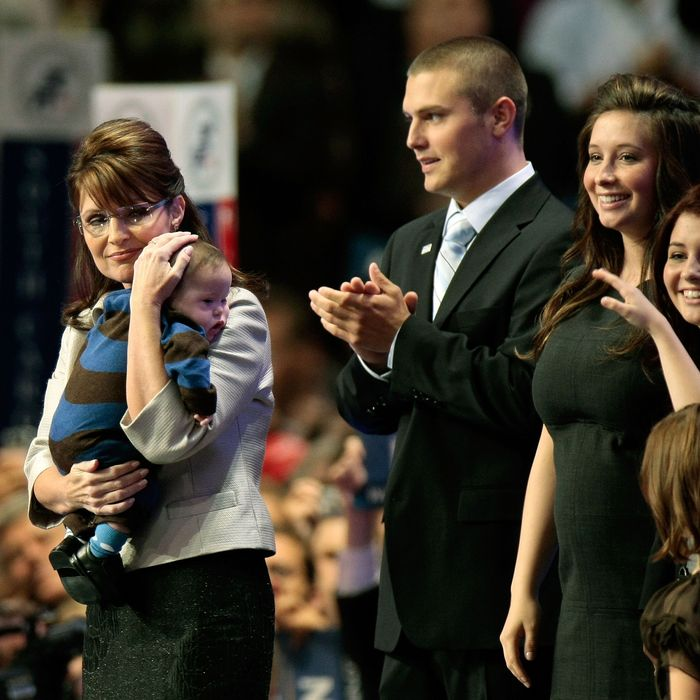 ST. PAUL, MN - SEPTEMBER 03: (L to R) Republican U.S vice-presidential nominee Alaska Gov. Sarah Palin holds her son Trig Palin as Track Palin, Bristol Palin and Willow Palin look on during day three of the Republican National Convention (RNC) at the Xcel Energy Center on September 3, 2008 in St. Paul, Minnesota. The GOP will nominate U.S. Sen. John McCain (R-AZ) as the Republican choice for U.S. President on the last day of the convention. (Photo by Win McNamee/Getty Images)