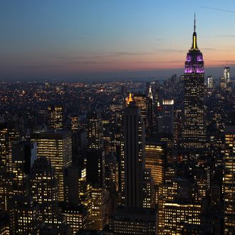 NEW YORK, NY - FEBRUARY 13: The Empire State Building towers over the Manhattan skyline on February 13, 2012 in New York City. The owner of the Empire State Building, Malkin Holdings, plans to raise up to $1 billion in an initial public offering on the 102 story Manhattan landmark. (Photo by John Moore/Getty Images)