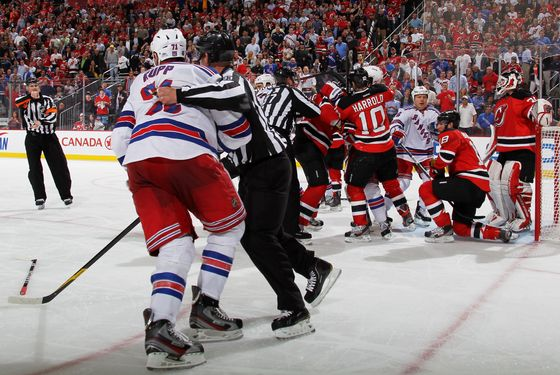 NEWARK, NJ - MAY 21:  Linesman Brian Murphy #93 pulls Mike Rupp #71 of the New York Rangers away from Martin Brodeur #30 after an altercation in the third period of Game Four of the Eastern Conference Final during the 2012 NHL Stanley Cup Playoffs at the Prudential Center on May 21, 2012 in Newark, New Jersey.  (Photo by Bruce Bennett/Getty Images)