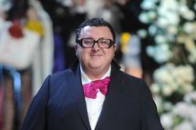Designer Alber Elbaz walks the runway during the Lanvin for H&M Haute Couture Show at The Pierre Hotel on November 18, 2010 in New York City.