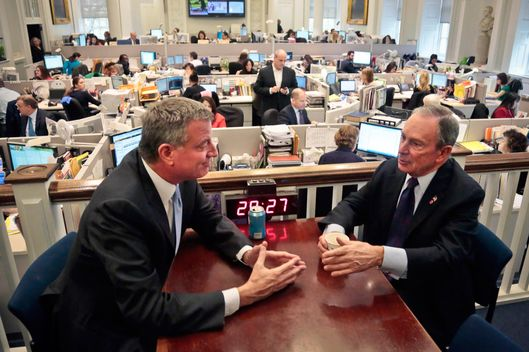 "New York City Mayor-elect Bill de Blasio, left, joins Mayor Michael Bloomberg for a meeting in the ""Bull Pen,"" the mayor's main City Hall office, on Wednesday, Nov. 6, 2013, in New York. De Blasio, the city's public advocate, defeated Joseph J. Lhota, a former chairman of the Metropolitan Transportation Authority, by a margin of about 49 percentage points, with 99 percent of the vote counted, to become the city's next mayor.  (AP Photo/Bebeto Matthews)"