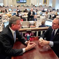 """New York City Mayor-elect Bill de Blasio, left, joins Mayor Michael Bloomberg for a meeting in the """"Bull Pen,"""" the mayor's main City Hall office, on Wednesday, Nov. 6, 2013, in New York. De Blasio, the city's public advocate, defeated Joseph J. Lhota, a former chairman of the Metropolitan Transportation Authority, by a margin of about 49 percentage points, with 99 percent of the vote counted, to become the city's next mayor.  (AP Photo/Bebeto Matthews)"""