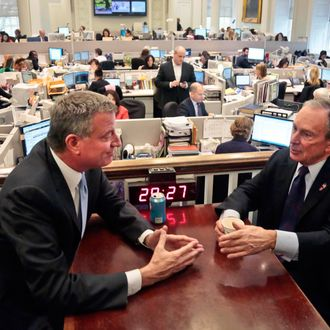 New York City Mayor-elect Bill de Blasio, left, joins Mayor Michael Bloomberg for a meeting in the