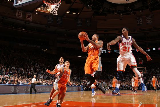 NEW YORK, NY - JANUARY 18: Shannon Brown #26 of the Phoenix Suns goes to the basket against Iman Shumpert #21 of the New York Knicks during the game on January 18, 2012 at Madison Square Garden in New York City.  NOTE TO USER: User expressly acknowledges and agrees that, by downloading and or using this photograph, User is consenting to the terms and conditions of the Getty Images License Agreement. Mandatory Copyright Notice: Copyright 2012 NBAE  (Photo by Nathaniel S. Butler/NBAE via Getty Images)