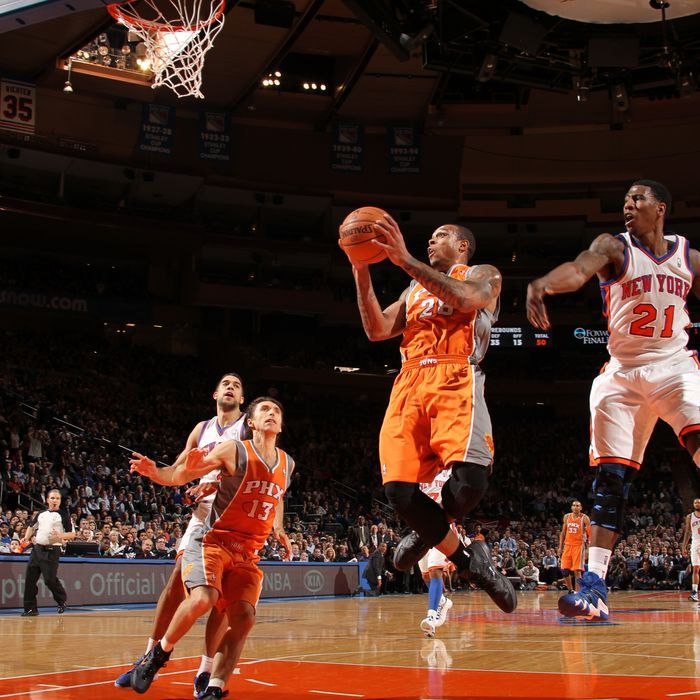 Shannon Brown #26 of the Phoenix Suns goes to the basket against Iman Shumpert #21 of the New York Knicks during the game on January 18, 2012 at Madison Square Garden in New York City.