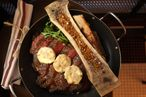 At least the $95 32-ounce cowboy rib-eye for two comes with roasted bone marrow.