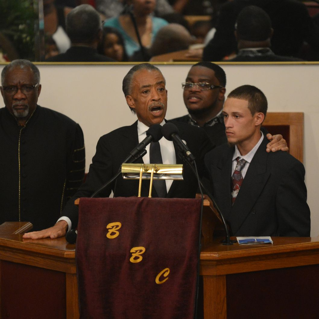 NEW YORK, NY - JULY 23: Reverend Al Sharpton introduces Ramey Ortiz, the civilian who video recorded the incident with the NYPD and the late Eric Garner, during the funeral service for Eric Garner held at Bethel Baptist Church on July 23, 2014 in the Brooklyn borough of New York City. Garner, 43, died after police put him in a chokehold outside of a convenience store on Staten Island for illegally selling cigarettes. (Photo by Julia Xanthos-POOL/Getty Images)
