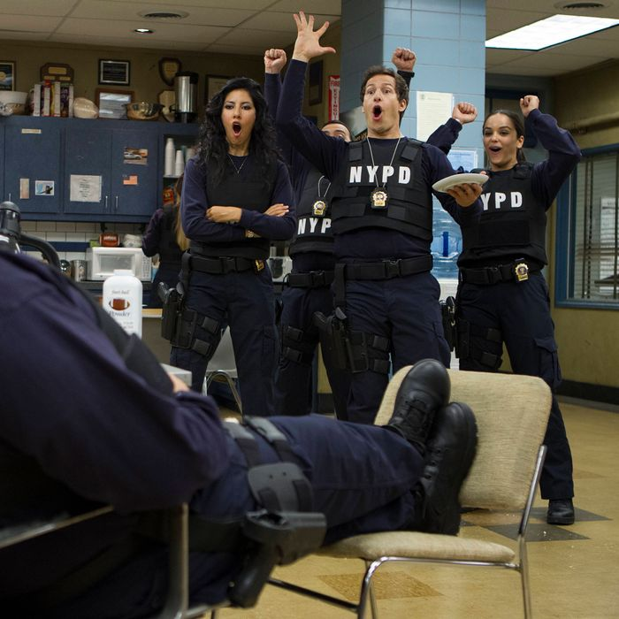 BROOKLYN NINE-NINE: Detectives Diaz (Stephanie Beatriz, second from L), Peralta (Andy Samberg, third from L) and Santiago (Melissa Fumero, R) have fun with Scully (Joel Mckinnon MIller, L) in the