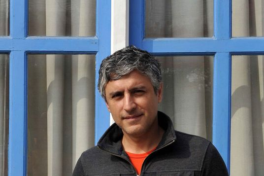 Reza Aslan, an Iranian-American writer and scholar of religions poses for a photo shoot during the Jaipur Literature Festival, at Diggi Palace on January 18, 2013 in Jaipur, India.