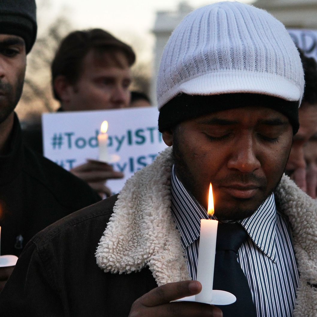 Faisal Ali (R) of Colorado Springs, Colorado, joins other people outside the White House to participate in a candle light vigil to remember the victims at the Sandy Hook Elementary School shooting in Newtown, Connecticut on December 14, 2012 in Washington, DC.  According to reports, there are about 27 dead, 20 of them children, after a gunman opened fire in at the Sandy Hook Elementary School. The shooter was also killed.WASHINGTON, DC - DECEMBER 14:  Faisal Ali (R) of Colorado Springs, Colorado, joins other people outside the White House to participate in a candle light vigil to remember the victims at the Sandy Hook Elementary School shooting in Newtown, Connecticut on December 14, 2012 in Washington, DC.  According to reports, there are about 27 dead, 20 of them children, after a gunman opened fire in at the Sandy Hook Elementary School. The shooter was also killed. (Photo by Alex Wong/Getty Images)
