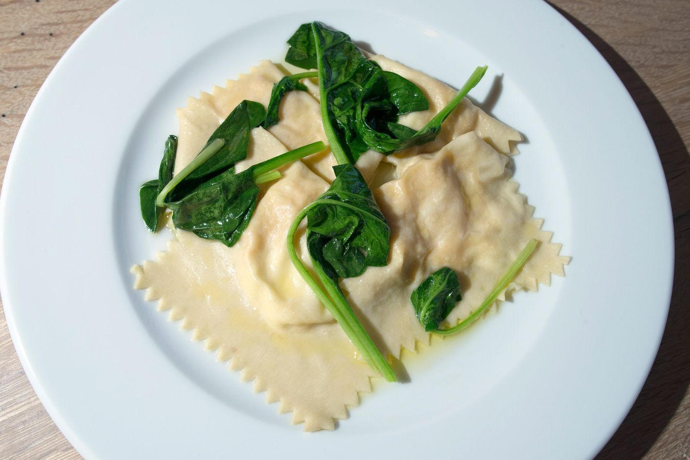 Ravioli of king crab and mascarpone with spinach.