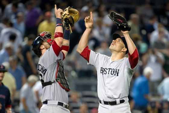 NEW YORK, NY - JULY 29: Alfredo Aceves #91 (R) and Jarrod Saltalamacchia #39 of the Boston Red Sox react after defeating the New York Yankees at Yankee Stadium on July 29, 2012 in the Bronx borough of New York City. (Photo by Christopher Pasatieri/Getty Images)