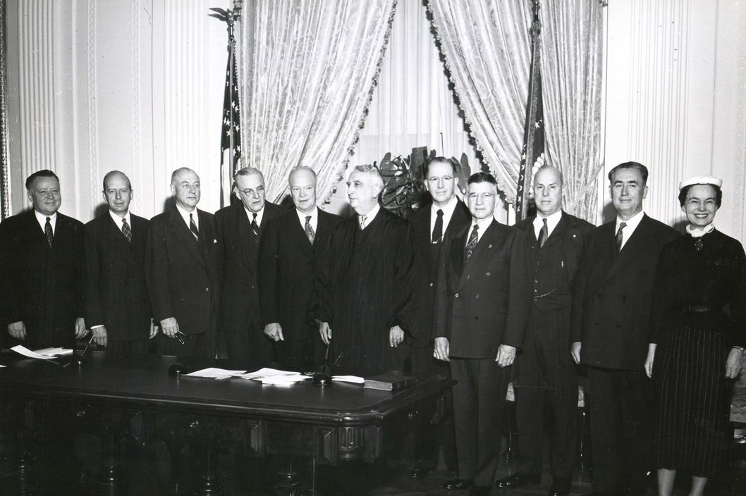 January 22, 1953, White House - Newly-inauagurated president Dwight Eisenhower standing in the White House with his cabinet.