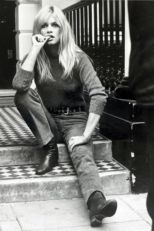 "Cinema Personalities, pic: 12th September 1966, French actress Brigitte Bardot, (born 1934), pictured relaxing in London, Brigitte Bardot, first appeared on screen in 1952, married Roger Vadim when she was 18 and became a major star after appearing in Director Vadim's 1956 film ""And God Created Woman"", She became a blond international sex symbol and sex kitten appearing in many French productions, later in the 1960's becoming popular in the USA, She retired from films in the 1970's and has devoted much time to animal rights causes, while now living a reclusive lifestyle  (Photo by Bentley Archive/Popperfoto/Getty Images)"