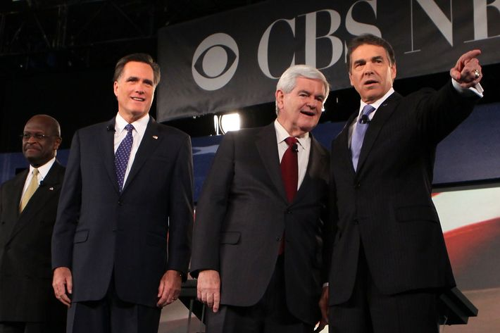 SPARTANBURG, SC - NOVEMBER 12:  Republican presidential candidates (L-R) businessman Herman Cain, former Massachusetts Governor Mitt Romney, former Speaker of the House Newt Gingrich (R-GA), and Texas Governor Rick Perry acknowledge audience prior to a presidential debate at Wofford College November 12, 2011 in Spartanburg, South Carolina. The debate was focused on national security and foreign policy.  (Photo by Alex Wong/Getty Images)