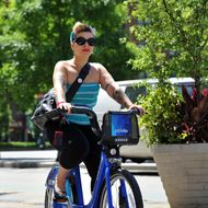 Sheryl Yvette rides a Citi Bike bicycle near Union Square from her home in Brooklyn  as the bike sharing system is launched May 27, 2013 in New York. About 330 stations in Manhattan and Brooklyn will have thousands of bicycles for rent.