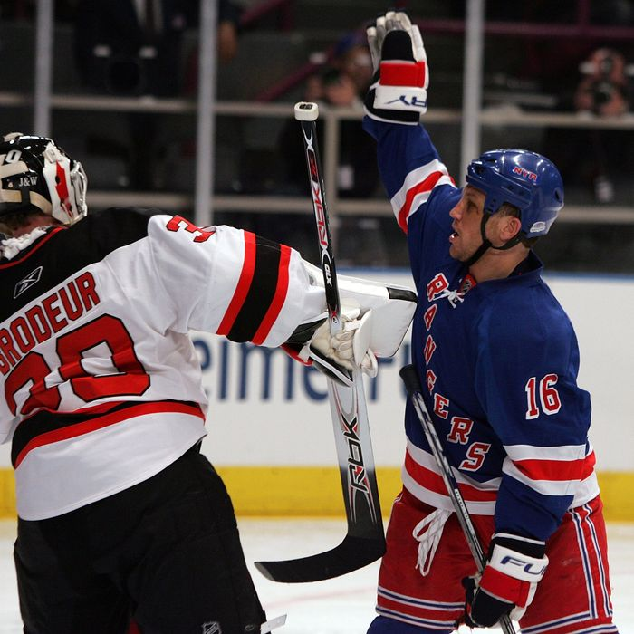NEW YORK - APRIL 13: Sean Avery #16 of the New York Rangers tries to screen Martin Brodeur #30 of the New Jersey Devils during game three of the 2008 NHL Eastern Conference Quarterfinals on April 13, 2008 at Madison Square Garden in New York City. (Photo by Jim McIsaac/Getty Images)