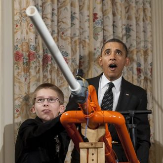 US President Barack Obama reacts as 14-year-old Joey Hudy of Phoenix, Arizona, launches a marshmallow from Hudy's