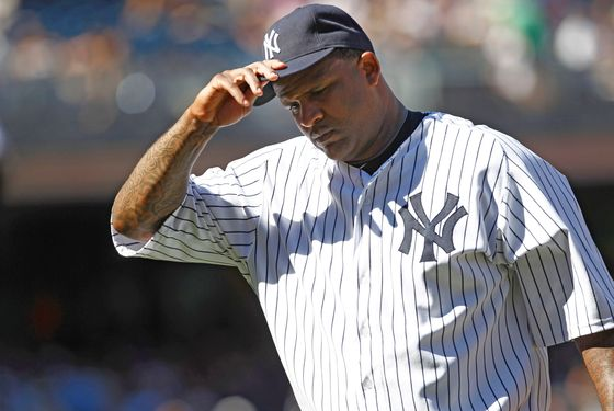 CC Sabathia #52 of the New York Yankees reacts as he walks to the dugout during their game against the Toronto Blue Jays at Yankee Stadium on August 29, 2012 in the Bronx borough of New York City.