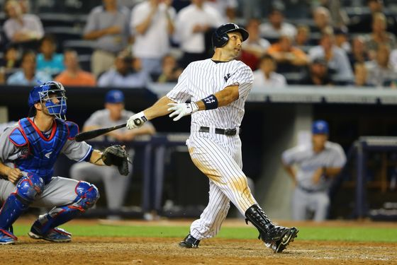 NEW YORK, NY - JULY 16:  Raul Ibanez #27 of the New York Yankees hits a grand slam against the Toronto Blue Jays in the eigth inning during their game on July 16, 2012 at Yankee Stadium in the Bronx borough of New York City.  (Photo by Al Bello/Getty Images)