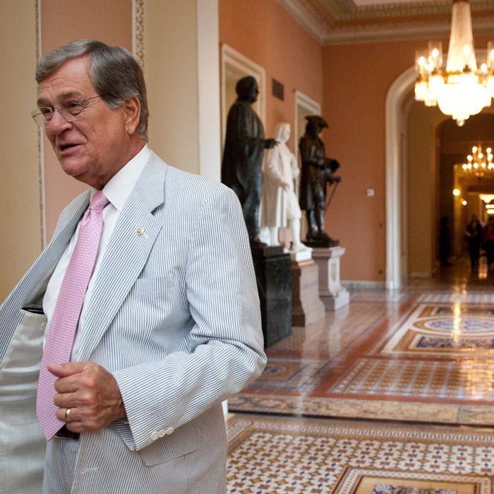 Former Sen. Trent Lott, R-Miss., shows off his seersucker suit in the Ohio Clock Corridor on Thursday, June 23, 2011. The third thursday of June is traditionally called Seersucker Thursday.