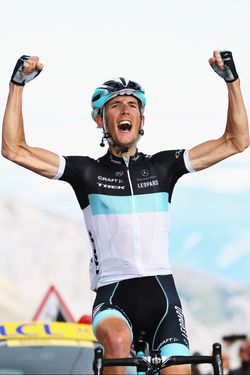 GALIBIER, FRANCE - JULY 21:  Andy Schleck of Luxembourg and Team Leopard-Trek celebrates winning stage eighteen of the 2011 Tour de France from Pinerolo to Galibier Serre Chevalier on July 21, 2011 in Serre Chevalier, France.  (Photo by Bryn Lennon/Getty Images)