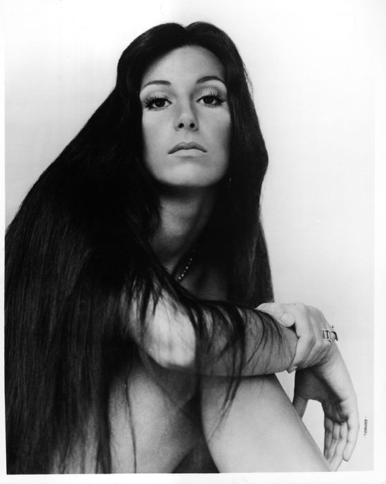 "There's <i>Moonstruck</i>'s cascading curls, the aquarium tube fascinator of ""Believe;"" and the spiky rocker mullet, but there's no Cher hair like seventies Cher hair. Waist-grazing and jet-black — and casually tossed with a flick of the wrist — Cher's locks helped land her five <i>Vogue</i> covers between 1972–1975. If we could turn back time…."