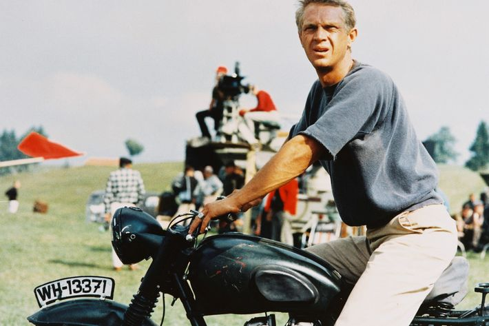 Steve McQueen on a motorcycle, wearing chinos. The Strategist on best chinos for men.