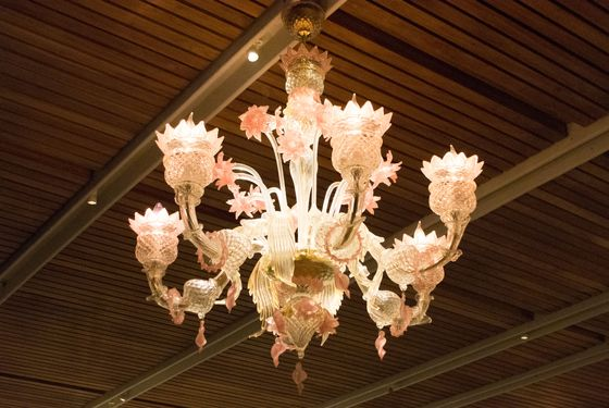 The flower-shaped chandeliers are made of Murano glass.