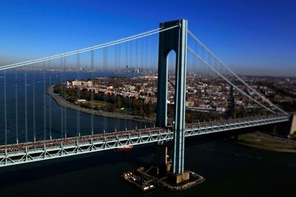 NEW YORK. NY - NOVEMBER 06: (EDITORS NOTE: Image was created using a variable planed lens.)  Runners cross the Verrazano-Narrows Bridge towards Brooklyn at the start of the ING New York City Marathon as seen from the air on November 6, 2011 in New York City.  (Photo by Chris Trotman/Getty Images)