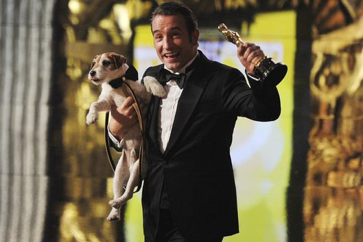 Best Actor winner Jean Dujardin walks of