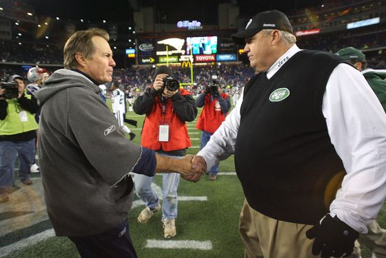 Bill Belichick of the New England Patriots shakes hands with Rex Ryan of the New York on November 22, 2009 in Foxboro, Massachusetts.