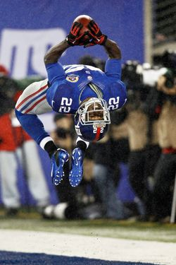 David Wilson #22 of the New York Giants celebrates his third touchdown of a game against the New Orleans Saints at MetLife Stadium on December 9, 2012 in East Rutherford, New Jersey.