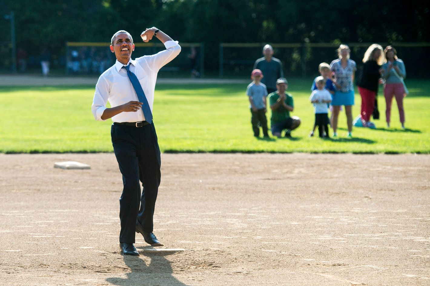 U.S. President Barack Obama throws out the first pitch at a little league baseball game at  Friendship Park May 19, 2014 in Washington, DC.