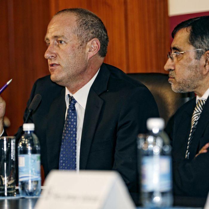 Dr. Andre van der Merwe (left).