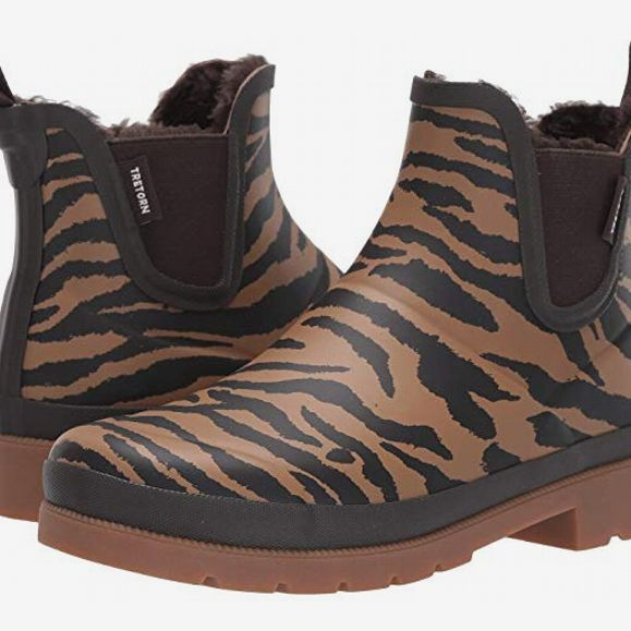 Short Chelsea boot style Tretorn Linawnt rain boots in a muted tan and black tiger print lined with faux-shearling. 33 Things on Sale You'll Actually Want to Buy: From Adidas to Le Creuset - The Strategist