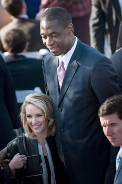 Former White House Press Secretary Dana Perino stands with former NBA Houston Rockets player Dikembe Mutombo before a dedication ceremony at the George W. Bush Library and Museum on the grounds of Southern Methodist University April 25, 2013 in Dallas, Texas. The Bush library is dedicated to chronicling the presidency of the United State's 43rd President, George W. Bush.