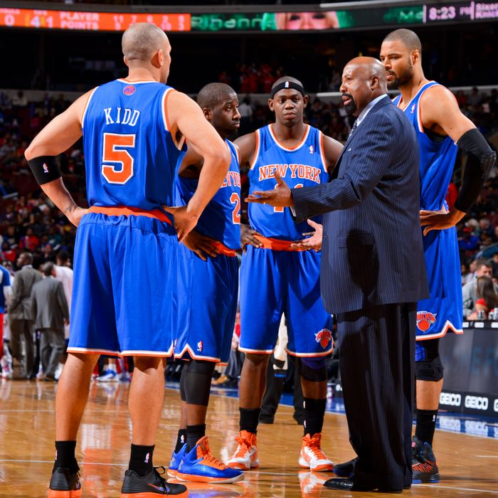 Head Coach Mike Woodson of the New York Knicks speaks to players Jason Kidd #5, Raymond Felton #2, Ronnie Brewer #11 and Tyson Chandler #6 while playing the Philadelphia 76ers at the Wells Fargo Center on November 5, 2012 in Philadelphia, Pennsylvania.