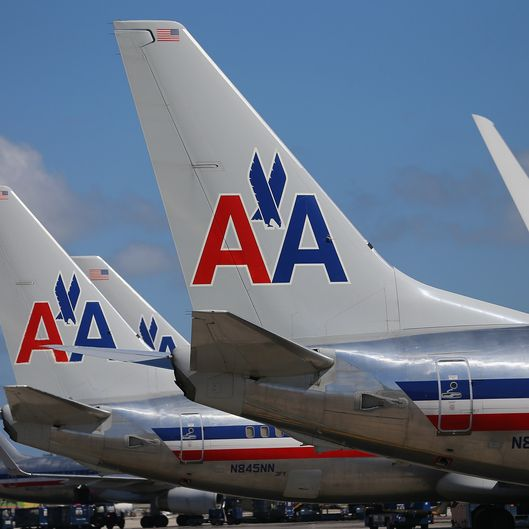 MIAMI, FL - FEBRUARY 07:  American Airline planes are seen at the Miami International Airport on February 7, 2013 in Miami, Florida. Reports indicate that a deal between American Airlines and US Airways to merge  may be set for early next week. If the deal goes through it would create the world's biggest airline.  (Photo by Joe Raedle/Getty Images)