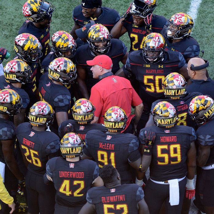 COLLEGE PARK, MD - OCTOBER 14: Head Coach DJ Durkin of the Maryland Terrapins talks to his team during the game against the Northwestern Wildcats on October 14, 2017 in College Park, Maryland.