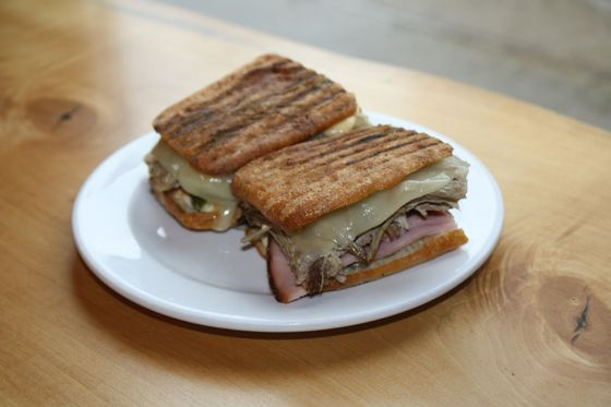 Doppio Pork: Pork shoulder, ham, Swiss cheese, pickles, and miso mayo.
