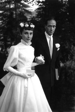 25th September 1954:  Film star couple Audrey Hepburn (1929 - 1993) and Mel Ferrer on their wedding day. Dress designed by Balmain.
