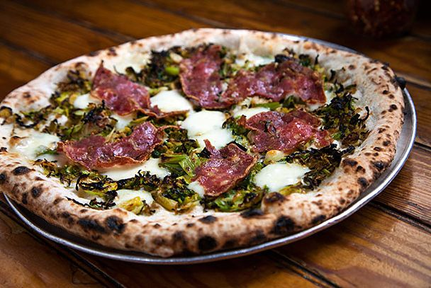 "<b>Erreyday I'm Brusslin'</b>    <a href=""http://nymag.com/listings/restaurant/robertas/index.html"">Roberta's</a>    <i>Brooklyn</i>  Pizza guys Chris Parachini and Brandon Hoy debuted this pizzeria in 2008, and while some might go for a more restrained, minimalist approach, toppings-wise, this is where you go for abundance, whimsy, and seasonal variety. You'll find Tallegio cheese, Brussels sprouts (pictured), housemade lardo, and one pie dubbed Paige's Breakfast Burrito, topped with potato, egg, sausage, and jalapeños."
