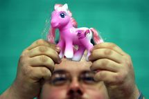 BRISTOL, UNITED KINGDOM - OCTOBER 26: Chris Sallis from Sheffield looks at a special edition My Little Pony at the International My Little Pony Convention at Redwood Hotel and Country Club, near Bristol on October 26 2007 in England. Fans of the toys were in the city to celebrate twenty five years Of My Little Pony. (Photo by Matt Cardy/Getty Images)